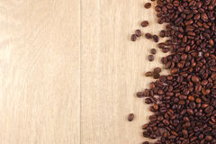 Coffee beans. On a wooden table Royalty Free Stock Photo
