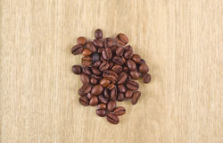 Coffee beans. On a wooden table Stock Photos