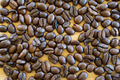 Coffee beans on wooden table. Royalty Free Stock Photos
