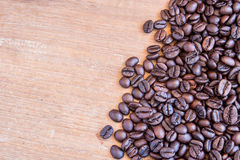 Coffee beans on wooden table background Stock Image
