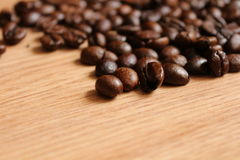 Coffee beans on a wooden table Stock Photography