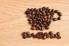 Coffee beans on a wooden table Royalty Free Stock Photo