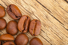 Coffee beans on wooden table - close up studo shot Stock Images