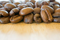Coffee beans on wooden table closeup. Royalty Free Stock Photo