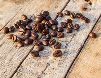 Coffee beans on wooden table Stock Photos