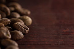 Coffee beans on wooden table, ready to brew delicious coffee Stock Image