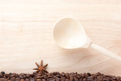 Coffee beans on wooden table with wooden spoon Royalty Free Stock Photo