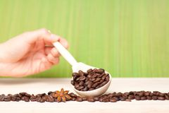 Coffee beans on wooden table with wooden spoon Royalty Free Stock Image