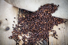 Coffee beans on wooden texture Stock Images