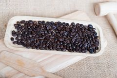 Coffee beans on wooden tray Royalty Free Stock Photo