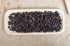Coffee beans on wooden tray Stock Photos