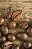 Coffee beans on the wooden vintage background Stock Image
