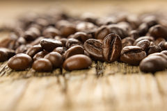 Coffee beans on the wooden vintage table Stock Photo