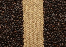 Coffee beans and a woven background Royalty Free Stock Photo
