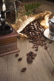 Coffee beass with antique machine grinder Stock Image