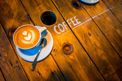 Coffee with beautiful art shape on the wooden Royalty Free Stock Photos