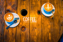 Coffee with beautiful art shape on the wooden Stock Photo