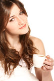 Coffee in bed. Young beautiful girl drinking coffee in bed in the morning Stock Image