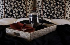 Coffee in bed. Fresh Coffee served in bed on tray Royalty Free Stock Photography