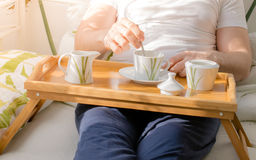 Coffee in bed. A cup of coffee for good morning.Drinking a morning cup of coffee.Daily routine.Holding a cup of coffee royalty free stock photos