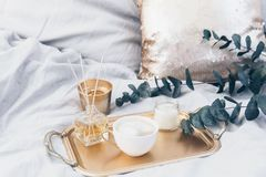 Coffee in bed. Still life elegant composition with gold elements. And eucalyptus royalty free stock photo