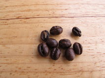 Coffee beens on wood background Royalty Free Stock Image