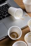 Coffee being dropped on laptop Royalty Free Stock Image