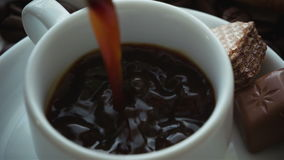 Coffee being poured into coffee cup stock footage