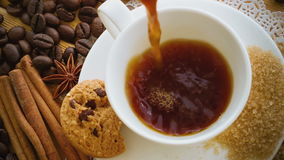Coffee being poured into coffee cup stock video footage