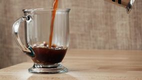 Coffee Being Poured into Transparent Cup stock video footage