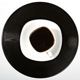 Coffee being on a vinyl record.  Stock Photography