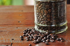 Coffee berry on wood table stock photos