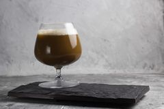 Coffee beverage. In a glass stone background Royalty Free Stock Photos