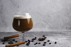 Coffee beverage. In a glass stone background royalty free stock photo