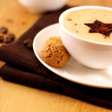 Coffee with Biscotti. Coffee with topping and biscotti royalty free stock images