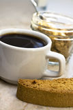 Coffee and biscotti. Cup of coffee on marble counter with biscotti royalty free stock photos
