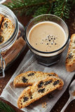 Coffee with biscotti or cantucci on wooden vintage table, traditional Italian biscuit Stock Image