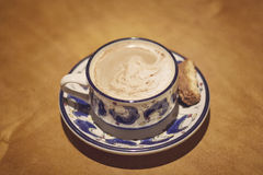 Coffee and biscotti. I enjoyed toasted sweet bread, biscotti, with my cappuccino Stock Image