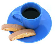 Coffee and Biscotti Isolated. A blue coffee cup and saucer with biscotti stock photo