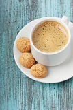 Coffee with biscuit cookies. On a turquoise vintage surface Stock Photography