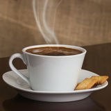 Coffee and biscuit Stock Images