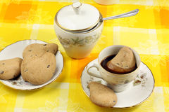 Coffee and biscuits Stock Images