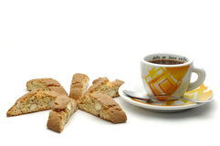 Coffee & Biscuits. Cup of coffee and almond biscuits isolated over white background Stock Image