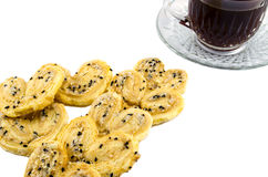 Coffee And Biscuits. Cup of coffee with crispy heart biscuits Royalty Free Stock Photos