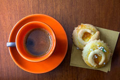 Coffee and biscuits. A frothy cup of coffee served with two homemade biscuits Royalty Free Stock Image