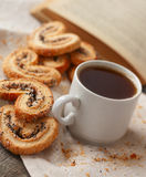 Coffee and biscuits with poppy seeds and sugar Royalty Free Stock Image