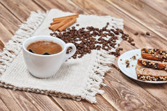 Cup of coffee with a cinnamon and biscuits.  stock image