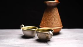 Coffee on black background stock footage