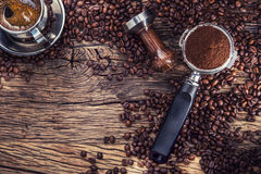 Coffee. Black coffee with coffee beans and portafilter on old oak wooden table stock images