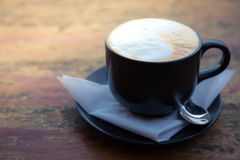 Coffee in black cup Stock Photo